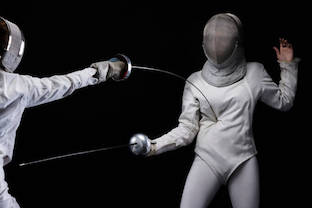 Fencing sport competition. Duel. Dark black background. Sporting Women.